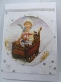 Winter-Grußkarte Kind auf Schlitten